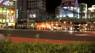 A busy crossing slide time lapse  at Shinjuku one of the 23 special wards of Tokyo, Japan. It is a major commercial and administrative centre