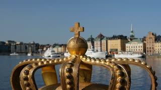 A golden Royal Crown on the Skeppsholmsbron bridge in Stockholm, Sweden