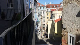 A narrow street with stairs in Lisbon Portugal