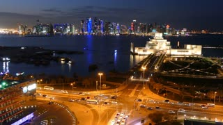 Aerial view from the Museum of Islamic Art on the Corniche with the Dhow Harbour at night in Doha Qatar