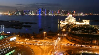 Aerial view time lapse from the Museum of Islamic Art with the Dhow Harbour and Doha skyline at night