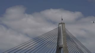 Airplane flying by the ANZAC Bridge in Sydney