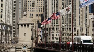 American and Chicago flags at the bridge