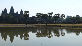 Angkor Wat with reflection in the lake on a bright sunny day