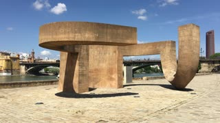 Art object in front of the Puente de Isabel II Bridge with tourists in Seville Spain