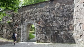 Backpacker walking at the Akershus Fortress in oslo Norway