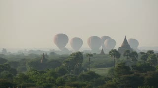 Balloons landing together close to the Pagodas in Bagan, Myanmar, Burma