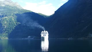 Big cruise ship at the Geiranger Fjord in Norway