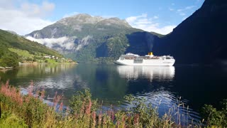 Big cruise ship in the Geiranger Fjord in Norway