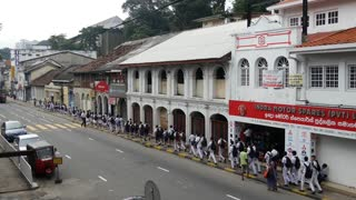Big group of school children passing by in kandy, Central Province, Sri Lanka