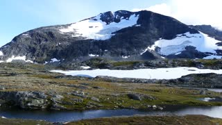 Big mountain with snow in Jotunheimen National Park Norway