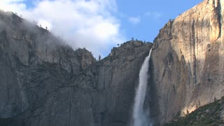Big mountain with waterfall in the shadow