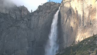 Big mountains with waterfall in Yosemite National Park zoom out