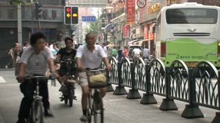 Bikes and people in the streets of Shanghai