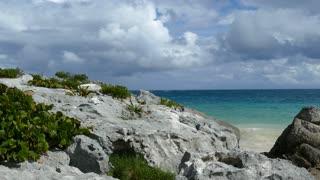 Blue sea coastline with rocks in Tulum Yucatan, Mexico