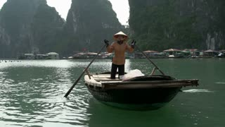 Boat for tourist to sail through the fishing village in Ha Long Bay