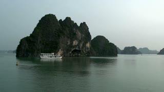 Boat sailing through Ha Long Bay in the morning