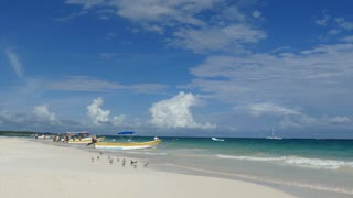 Boats and birds at Tulum beach in Yucatan, Mexico