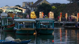 Boats with the Cau An Hoi bridge at the background in Hoi An Vietnam