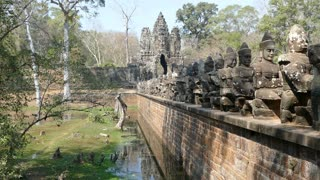 Bridge with statues and gate in Angkor Wat Cambodia