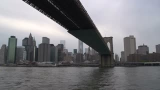 Brooklyn bridge and Freedom tower from the East river , New York City, USA