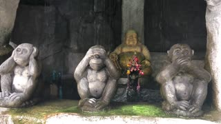 Buddha and hear, see and speak no evil monkeys at the entrance  of the golden mount in Bangkok, Thailand