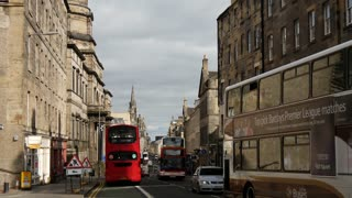 Busses and other traffic driving in the old town of Edinburgh Scotland