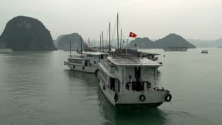 Busy bay with cruise ships in Ha Long Bay