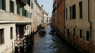 Cargo boat in the canal of Venice Italy