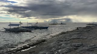 Catamaran Boat in the water during low tide in the morning at Balicasag Island in Bohol the Philippines
