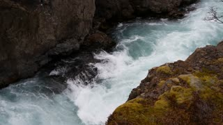 Close up from a stream of the Hraunfossar waterfalls in western Iceland