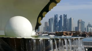 Close up from the Pearl Monument and fountain located along the Dhow Harbour with the Doha skyline in the background