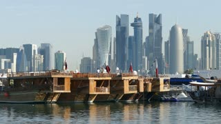Close up from Traditional Dhow, Arab sailing vessels in Dhow Harbour and Doha skyline in the morning