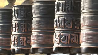 Close up spinning prayer wheels at the Monkey temple, Swayambhunath Stupa