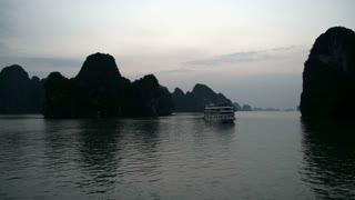 Cruise ship in Ha Long Bay before sunrise