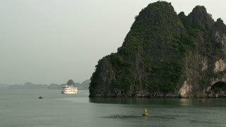 Cruise ship with a big mountain in the front