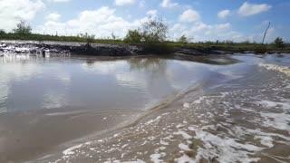 Cruising through a small mud river in Suriname