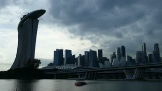 Dark clouds above Marina Bay Sands and the skyline from Singapore
