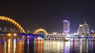 Dragon bridge with a cruise ship in the evening in Da Nang, Vietnam