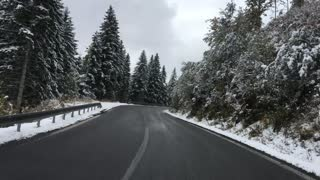 Driving through a snowy Low Tatras National Park in Slovakia