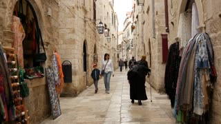 Elderly lady and man walking in the old town streets of Dubrovnik Croatia