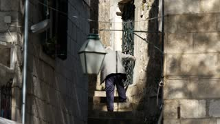 Elderly man at the old town stairs in Cavtat Croatia