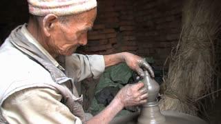 Elderly man making pottery in Bhaktapur Nepal