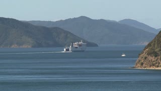 Ferry leaving harbor picton zoom-out, New Zealand