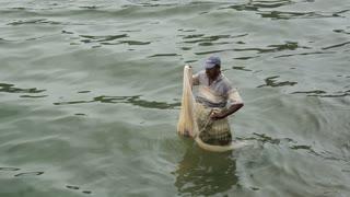 Fishermen fishing with a net in a river in Negombo, west coast, Sri Lanka