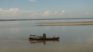 Fishing boat at the Irrawaddy river in Bagan, Myanmar, Burma