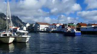 Fishing boat passing by at the village Henningsvaer Norway