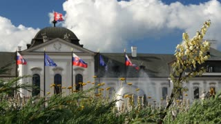 Flowers, flags and water Fountain in front of The Presidents (or Grassalkovich) palace in Bratislava Slovakia