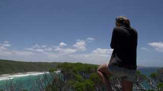 Girl photographing from the Observatory Point at the Great Ocean Drive, Esperance, Western Australia