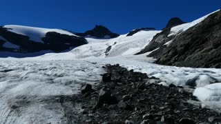 Glacier and snowy mountains in Jotunheimen National Park Norway